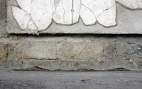 Fig. 18.53. Porticus 60, west wall, spoliated socle. Photo: S. Barker.