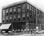 A black-and-white photograph of the first Canadian Canoe Company factory. The factory stood on Water Street in Peterborough from 1892–1904 near the rail office where all the canoes made in town were shipped.