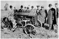 Henry Ford, Lord Northcliffe (second and third from right) and the Northcliffe mission with a Fordson tractor. Dearborn, October, 1917.