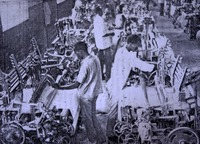 Weavers using mechanized looms at a Kano textile mill in the 1950s.