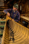 Rollin Thurlow working in his shop at Northwoods Canoe Company in Atkinson, Maine. Thurlow restores old wood-and-canvas canoes and builds his own Atkinson Traveler canoes along with new Morris, Rushton, and E. M. White boats.
