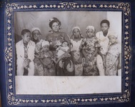 Black and white photograph showing Kaduna family members wearing cotton print garments.