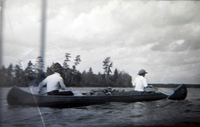 A black-and-white photograph of Jule and Mae Marshall paddling a canoe.