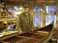 Tom Seavey with a 1905 Morris Veazie canoe that he restored.