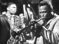 Figure 17. Saxophonist John Coltrane, seen behind Miles Davis, listens intently to Davis's improvised solo with his eyes closed.