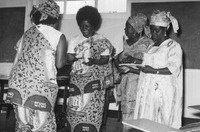 Fig. 2: Photograph of WCNU women leaders in Buea, 1972. (left to right) Prudencia Chilla (smiling), Gladys Endeley, Gwendoline Burnley (looking down at paperwork).