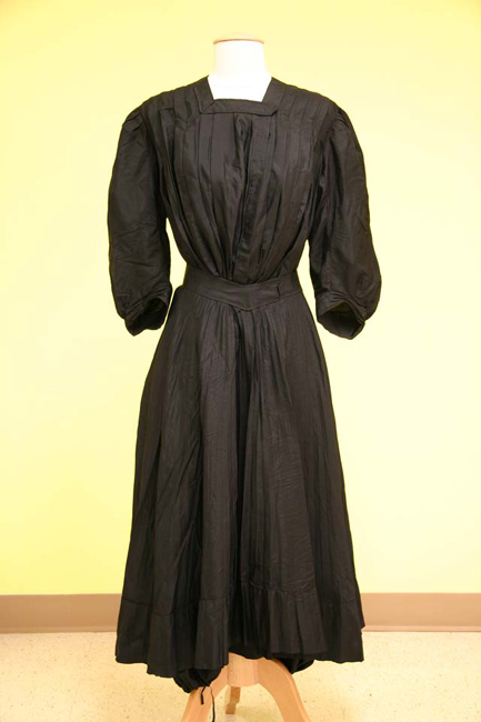 The black silk suit has a matching skirt that could be worn over the bloomers.
