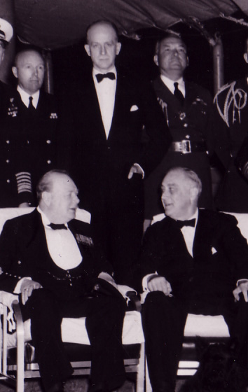 Welles, in black tie, placed between Churchill and FDR during a formal dinner at the Atlantic Conference. Franklin D. Roosevelt Library, npx 77-138 (2) FDRL.