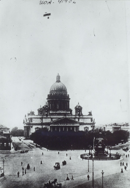 An unidentified pilot flies over St. Isaac's Cathedral in St. Petersburg ca. 1911.